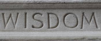 Stone engraving of the word 'Wisdom'